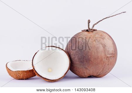 coconut half clipping path for coconut milk and brown ripe  coconut  on white background healthy fruit food isolated