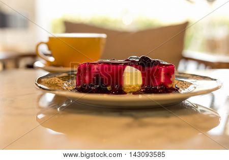 Selected focus blue berry cheese cake on marble table
