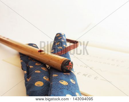 Traditional Japanese bamboo flute on blurred white background
