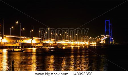 The Suramadu Bridge at Twilight time Surabaya Indonesia. Is the longest Bridge in Indonesia.