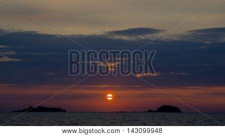 Sunset over Nagasaki, Japan with Hashima Island, also known as Gunkanjima (battleship island) in the background.