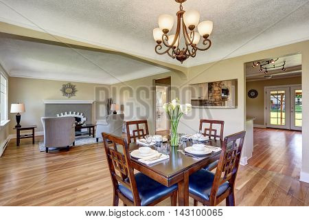 Open Floor Plan. View From Dining Area With Wooden Table Set.