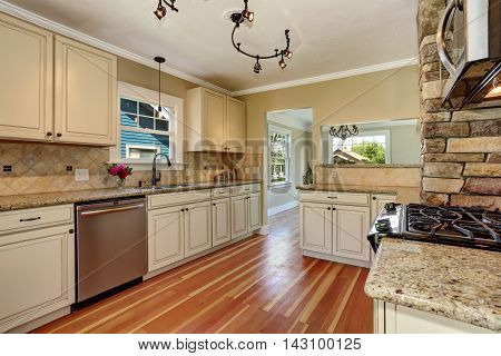Kitchen Room With White Cabinets, Stainless Steel And Hardwood Floor