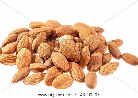 Group of almonds isolated on white background .