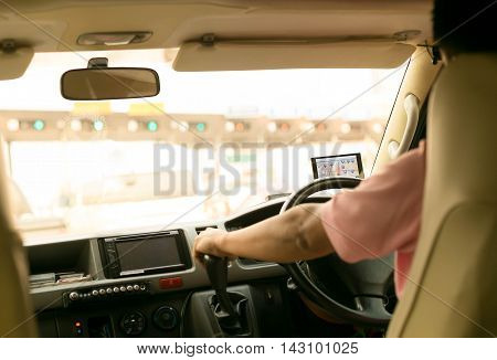 Man driving a car with navigation device on road trip