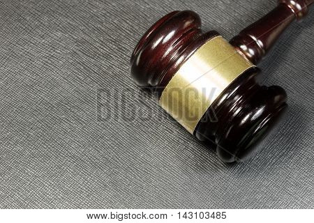Law gavel on the black leather background