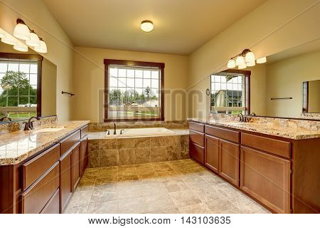 Luxury Bathroom Interior With Granite Trim And Two Vanity Cabinets.