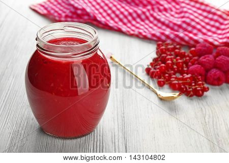 Fresh berry cocktail on wooden background