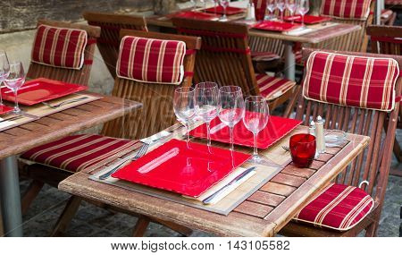 Restaurant with table settings for a dinner party