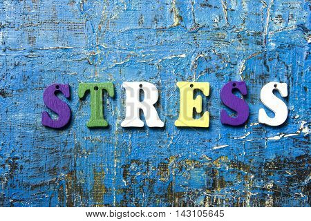 STRESS word written on abc letter at abstract grunge background