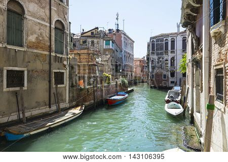 VENICE,ITALY-AUGUST 12,2014:Venetian canals hidden to the many tourists during a sunny day.