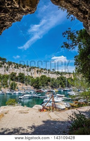 Calanques in Provence. The picturesque gulf with turquoise water at coast of the Mediterranean Sea. White sailing yachts in the sea fjord