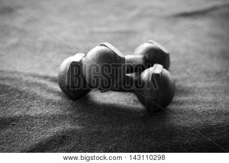 Old dumbbells bw photo, the concept of retirement