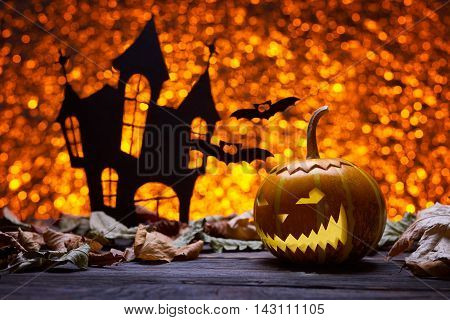 Pumpkin for Halloween, lamp pumpkin, antique wood, bat silhouette, celebrating halloween, smiley on a pumpkin, the silhouette of the castle, autumn dry leaves, bright background