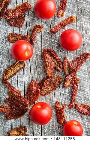 Fresh and dried tomatoes. Top view.