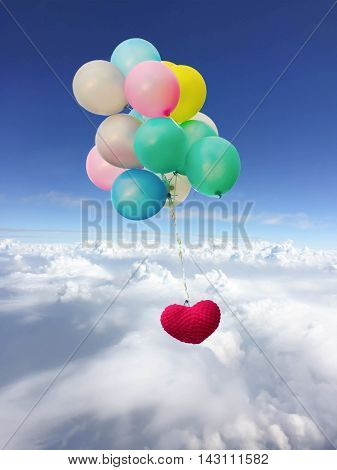 Concept love and care Beautiful red heart shape with balloon over blue sky and clouds
