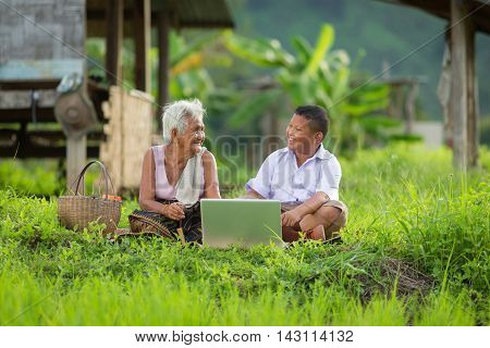 Grandmother and granddaughter play computer concept development of technology.