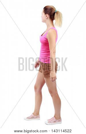 back view of walking woman . going gir in motion. Rear view people collection.  backside view of person. Isolated over white background. Sport blond in brown shorts and misses looking to the side.