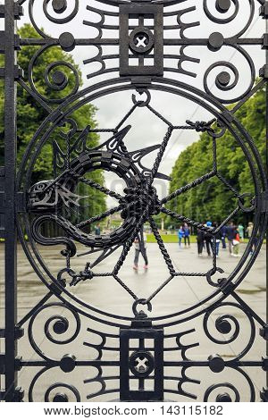 OSLO NORWAY - JULY 1 2016: This is fragment of the wrought iron gate main entrance to the Vigeland Sculpture Park.