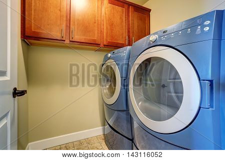 Laundry Interior With Modern Blue Appliances.