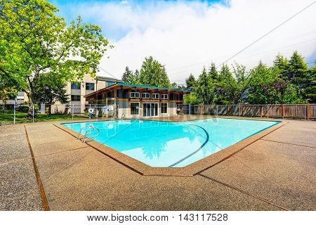 Residential Building With Swimming Pool And Patio Area.