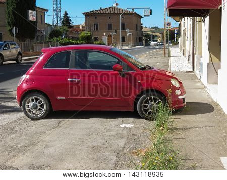 SIENA ITALY - CIRCA JULY 2016: red Fiat New 500 car parked on a street
