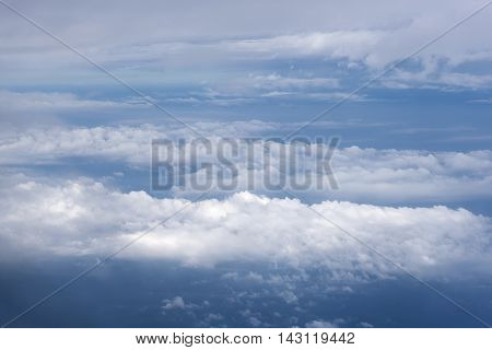 blue sky with clouds aerial view from airplane cloudscape landscape