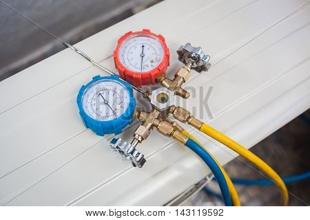 Gauge, coolant for air conditioning technician to install.