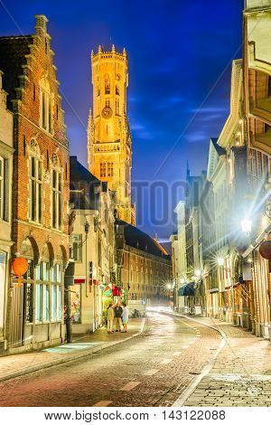 Bruges Belgium. Markt is dominated by the Belfry or Belfort octagonal belltower with 83 m built in 13th century. Flanders Belgian Felmish region.
