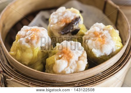 closeup dim sum in bamboo steam containers Traditional chinese food