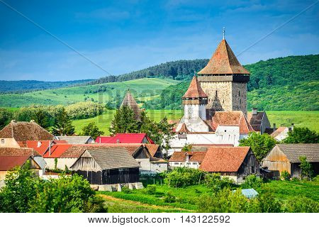 Homorod Romania. Fortified church in romanian medieval village built by Saxons in Transylvania world heritage site.