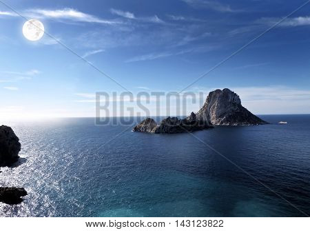 Full moon over Es Vedra, the magic rock formation on ibiza.