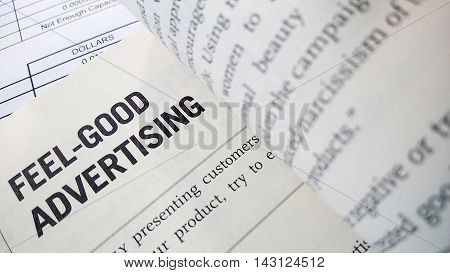 Feel good advertising word on the book with balance sheet as background
