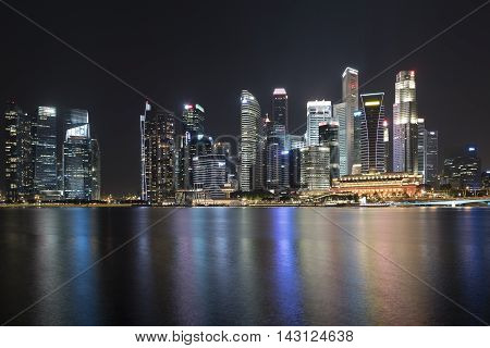 cityscape of Singapore at night with copy space