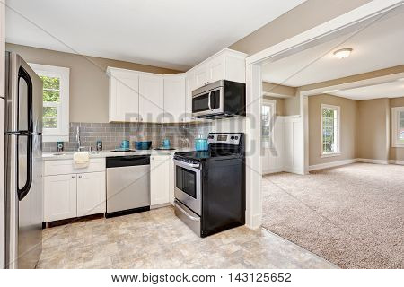 Kitchen Room Interior With White Cabinets And Tile Floor.