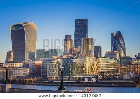 London, England - Bank. The world famous business district of London with skyscrapers and clear blue sky