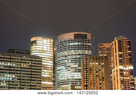 Modern cityscape at night background. Office skyscrapers of Sydney downtown at dusk. Copy space long exposure