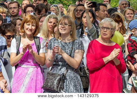 Moscow Russia - August 14 2016: Independence Day of India Celebration. Ratha Yatra. Harinam sankirtana. Spectators.