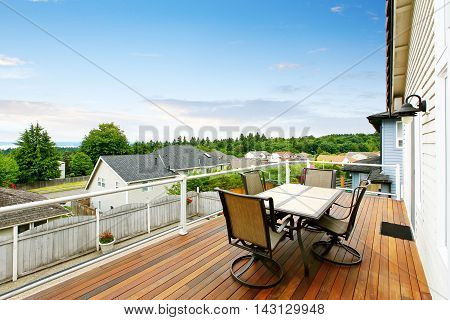 Balcony House With Glass Railings, Table Set And Perfect View.