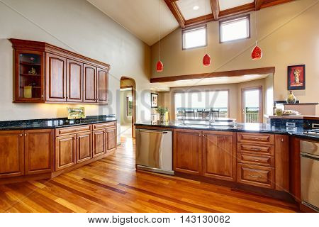 Kitchen Room Interior With Granite Counter Top And Wooden Cabinets.