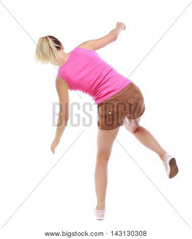 Balancing young woman.  or dodge falling woman. Rear view people collection.  backside view of person.  Isolated over white background. Sport blond in brown shorts balancing on one leg.