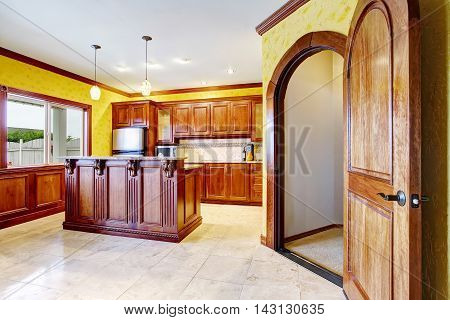 Kitchen Room Interior With Wooden Trim Island And Tile Floor.