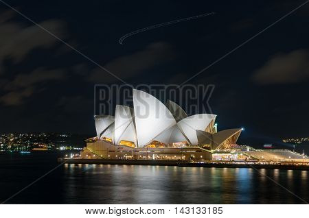 sydney australia - jul 10 2016: sydney opera house at night. iconic sydney architecture sightseeing against dark sky on the background