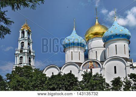 Sergiev Posad, Russia - may 28, 2016: Gold and blue dome over the Cathedral of the Trinity-Sergius Lavra. The Shrine of all Christians. The center of pilgrimage of the Christian world. Sergiyev Posad is included into the Golden ring of Russia.