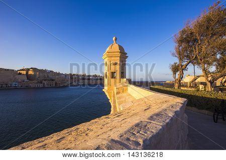 Malta, Senglea - Watch tower at Garjola gardens with panoramic view of Valletta at sunset