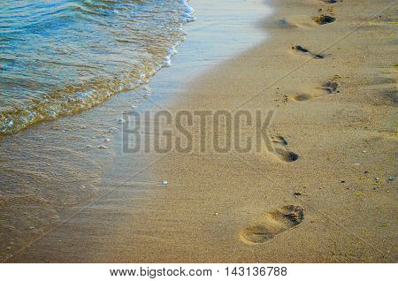 beach waves and footprints in the sand