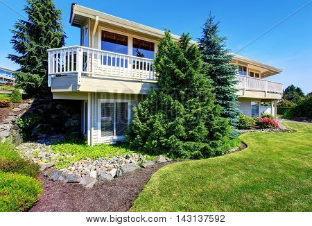 Luxury Two Level House Exterior With Large Balcony