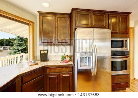 Modern Kitchen  With Wooden Cabinets And Granite Counter Top.