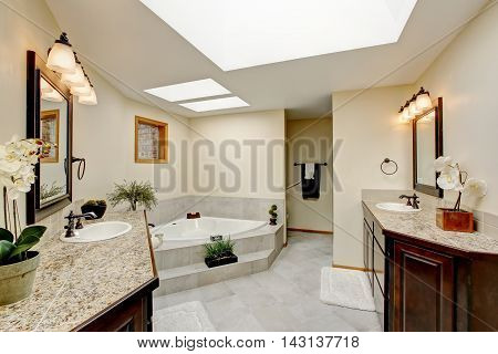 Modern Bathroom With Two Vanity Cabinets With Granite Counter Top