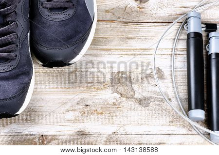 Fitness background with sneakers and skipping rope. Healthy lifestyle concept with copy space